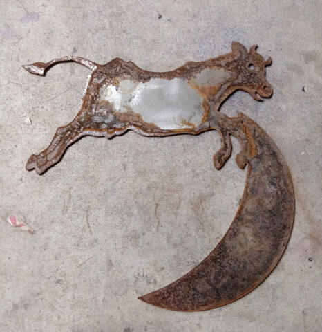 Cow jumping over the moon (rusted steel)