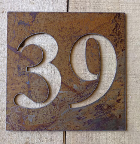Square rusted steel address sign
